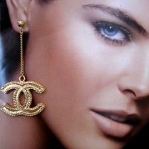 Gold Chanel drop earrings.